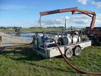 Pumping out and returning effluent to farm.